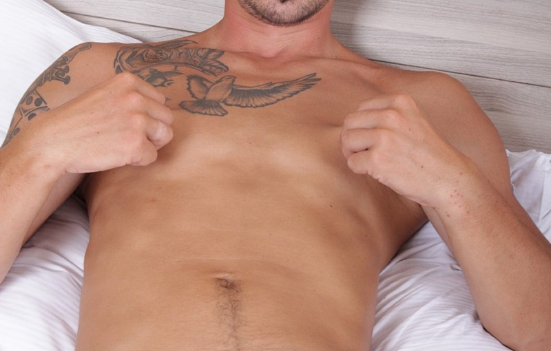 27 year old Chris Reed shows off his tattooed toned body jerks his big uncut cock